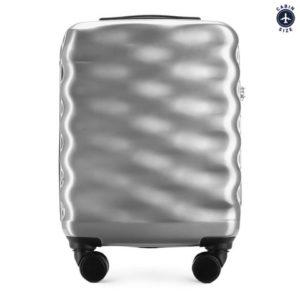 mała walizka z kolekcji Wavy Style