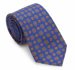 modne krawaty: granatowy krawat ze wzorem w kolorze miedzi