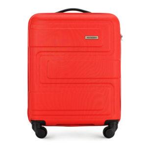 Mała walizka w geometryczny wzór